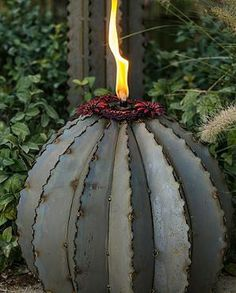 Ferocactus Torch- carefully crafted to realistically represent the beloved Saguaro Cactus, this torch will illuminate your landscape. Love this!