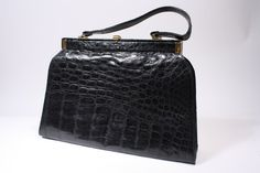 Beautiful Huge Vintage 50's Alligator Handbag.  http://www.riceandbeansvintage.com/NewArrivals/Vintage_50s_Alligator_Handbag.html