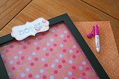 Picture frame - scrapbook paper cut to size = cute dry erase bpard for kids' bedrooms...