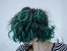 Get the curls back when it starts growing out and this could be fun. Another dive into all-over teal.