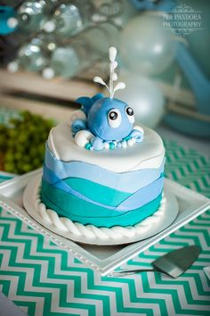 www.inapandora.com #cake #babeshower Nautical baby shower for a boy. Blues, green, and gray. Whales. Balloon Garland. Facebook.com/SimpleElegancebySK Facebook.com/SigntureDesserts