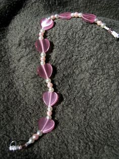 Pink glass heart beads interspaced with pink and white glass pearls. Silver-toned lobster claw clasp. Large size. Free shipping.