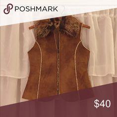 A vest It's a faux fur vest Fabulous Furs Jackets & Coats Vests