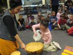 """Make Your Own """"Jibara-Style"""" water drum from easy supplies in your home! Great project for musical fun or as outdoor water play!"""