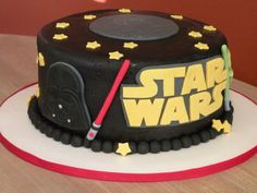 Made for a little boy's birthday who had 3 requests: he wanted a Star Wars cake, that was black, and had 2 lightsabers. The other trick is it had to be flat on top it could be boxed for his grandparents could take it on and airplane from Ohio to...