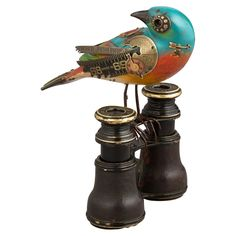 Teal Turned Head Bird on Binoculars