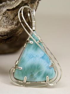 Aqua Larimar Triangular Wire Wrapped Pendant, Handmade In Sterling Silver. $79.00, via Etsy.