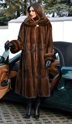 Great coat, boots, hair, and don't forget the car!!