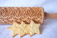 The wooden rolling pin for making cookies. The dough can be made of salt-, sugar- or ceramic-mass! Use your imagination. The rolling pin is