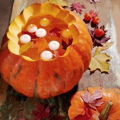 Create a dazzling autumn display with elegant floating candles. More Halloween decorating:  http://www.bhg.com/halloween/outdoor-decorations/outdoor-halloween-decorating-with-pumpkins/?socsrc=bhgpin092913floatingcandles&page=7