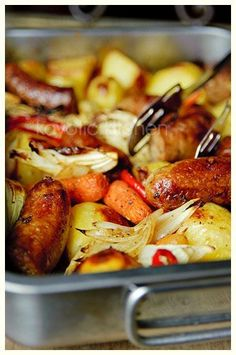 sausage, potatoes, carrots, peppers, onions, herbs.