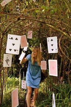 Create more floating decor like these floating playing cards from About.com Kids' Parties & Celebrations. {DIY Tip} Using full-sized playing cards, pierce a tiny hole in the top part of each card and string transparent fishing gut or similar so that it can be hung from different heights and at different angles.