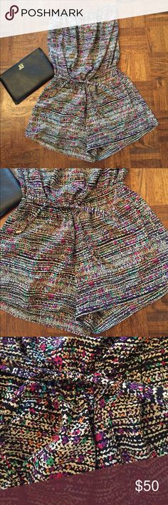 Romper Black and Ivory with specks of fun colors throughout. Pockets and drawstring waist! Like new- no signs of wear or fading Zoa Pants Jumpsuits & Rompers