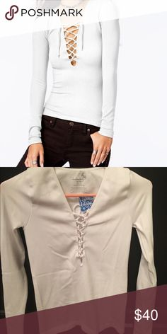 Free People Lace-Up Top 92% nylon 8% spandex. New with tags. Size xs/s. Free People Tops Tees - Long Sleeve