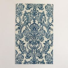 Hand tufted by artisans, our plush wool area rug is printed with an ornate World Market exclusive design. It adds upscale appeal to your home at a remarkable value.