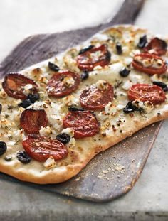 This beautiful flatbread is inspired by ingredients from the Mediterranean -- the feta adds a salty, slightly tart taste that balances the sweet, smoky flavors of the oven-roasted tomatoes. Cut it ...