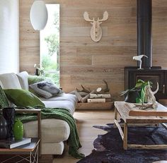 Colours lounge room green wood black natural
