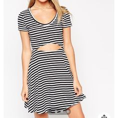 HP  NWT ASOS DRESS Size 6. Adorable for so many occasions! Perfect for the beach or a night at a fun restaurant. Love the classic black and white stripes paired with the edgy cutout. ASOS Dresses Mini