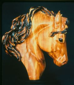 High relief horse head...carved of aromatic red cedar...