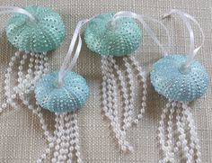 Beach Christmas Ornament. These beautiful Sea Urchin Jellyfish have been made with real sea urchins that have been painted in a pearl paint (various colors are available) and finished with pearls, ribbon and iridescent glitter to make these gorgeous hanging ornaments. They would