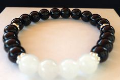 FREE SHIPPING within USA.!!!!!!!  Black Jade and snow quartz stretch bracelet, fits up to 6&3/4 wrist. Beads are 8mm in size.  Black Jade urges