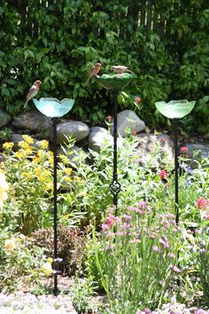 These bird feeders were so easy to make with bowls from the Dollar Store and stair railings from Lowes. I used silicone adhesive to put the two together.