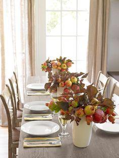 Fashion pomegranate centerpieces as festive fall centerpieces.