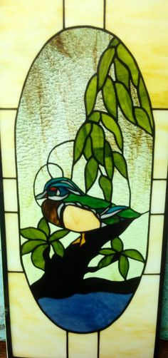 "The client is a woodcarver.  He wanted a wood duck. All the colors are correct including its red eye.  This window is 15"" x 30"""