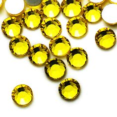 """"""" Citrine """"- is a flatback rhinestone that can be used as designs to any fabrics, shirts, cellphone, shoes and almost anything. By a use of our <a href=""""http://www.rhinestonesuperstore.com/shop/other-products/rhinestone-transfer-tape-mylar/"""">Mylar Transfer Tapes</a> or any adhesives, you can now design your own or you can choose a design you like and order in our <a href=""""http://www.rhinestonesupers..."""