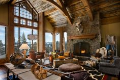 Rugged mountain architecture infused with striking colors, captivating shapes and modern-rustic design in this beautiful Montana retreat.