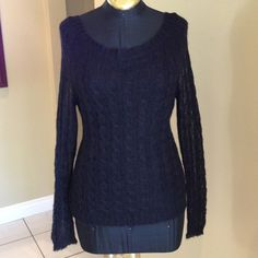 Black Bundle Sweater & Tank Top Love this so cute.  Sweater is light weight and beautiful knit work.  Comes with stretchy black tank that is removable !  Love this top great for gift for holidays for causal or business wear love it!!! Sweaters