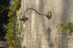 Bring a subtle, countryside charm to your outdoor lighting scheme with our elegant, long armed Stable Light that can be flat, or corner mounted. Hand finished in natural solid brass, the Stable Light has a lovely long, vintage-style swan neck that was originally designed to keep out of the way of stable doors and horses' heads! It is a robust, stylish design that incorporates a neat brass cap and hand blown clear glass shade to enclose the bulb and ensure it will withstand any storm.  Jim… Exterior Lighting, Outdoor Lighting, Vintage Style, Vintage Fashion, Modern Rustic Homes, Stables, Glass Shades, Solid Brass, Clear Glass