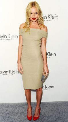 Kate Bosworth in a sleek, off-the-shoulder dress, red lip and red pumps at a Calvin Klein party