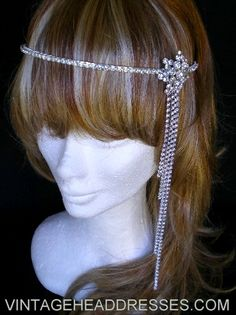 Gorgeous statement diamante headpiece, featuring a vintage 1940's piece, with long trailing diamante strands which create interest and movement. Can be worn as a headband, or further forward on the forehead as a hairband.