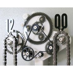 Industrial and Contemporary Clocks and Home Decor. Featuring laser cut acrylic and formed aluminum elements. Commonly known as chain clocks.