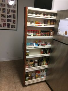 I was finally able to find sometime to make my own roll out. Thanks to my mom, her garage (which had a lot if leftover wood) and a weekend Kitchen Pantry Design, Kitchen Organization Pantry, Rustic Kitchen, Interior Design Kitchen, Diy Kitchen, Kitchen Storage, Kitchen Spice Racks, Diy Spice Rack, Spice Rack Slide Out