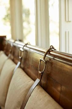ideas for securing bench seating back cushion to wall. this hardware with leather strap and linen get my vote.
