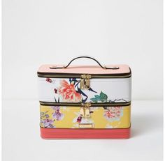 Checkout this Yellow floral print vanity case bag from River Island