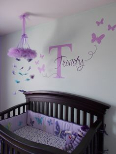 Bought this wall decal and hanging mobile on etsy!!!  The mobile is so cute and I had it custom made for my baby girl!!!!      http://www.etsy.com/listing/103295448/butterfly-tutu-mobile-custom-made?ref=pr_shop      http://www.etsy.com/listing/89645698/vinyl-wall-decal-monogram-initial-and