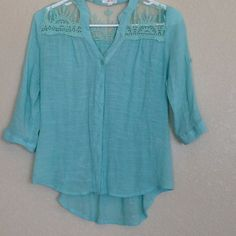 •Teal High Low Blouse• No stains or tears. Has button on sleeves to roll them up. The tie in the back does not adjust. Save 20% on bundles. Tops Blouses
