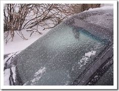 Vinegar to de-ice windows.  Fill a spray bottle with 2/3 white vinegar & 1/3 water and spray onto windows. Ice will melt right off!
