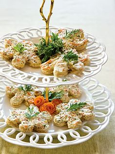 In a medium bowl, combine cream cheese, carrots, pine nuts, parsley, salt, and garlic powder. Using a hand mixer on medium-low speed, beat until carrots are in small pieces and mixture is uniformly combined. Spread a heaping teaspoon of cream-cheese mixture on each piece of toast. Garnish with fresh parsley, if desired.