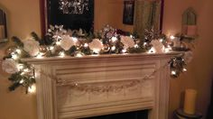 Glittered white roses, vintage silver balls and garlands, and tin snowflakes. Beautiful!