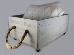 Reclaimed Wine Box Rolling Storage Caddy. The wine comes from the Bordeaux region of South Western France which claims its notability as an area for vineyards because of its particular climate. Great place to store pillows, throws, and coffee- table clutter