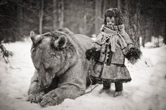 I have no info about this photo, other than I saw it on Velveteen Tigress's Ursine board. That bear is big. I wondered if the little girl was riding it, but I didn't see a saddle.