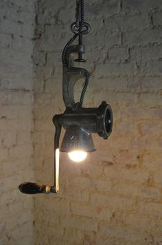 To Transform Simple Kitchen Utensils Into Light Fixtures How about a pendant light made from a meat grinder?How about a pendant light made from a meat grinder?