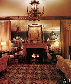 The living room of photographer and Hollywood hostess Jean Howard's Los Angeles house. The striking wall was designed by decorator William Haines in the 1940s.