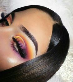 Purple and yellow cut crease eyeshadow look. I love this bold, daring look.