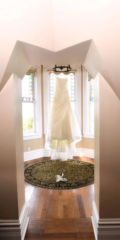 nothing is more elegant and going to make a woman feel more beautiful than seeing her wedding dress floor length hanging from the hook of a victorian home!        Make your dream wedding come true:                     1-866-383-6810 #dreamwedding #keywestwedding #dayofwedding #weddingplannerkeywest #planmywedding #wedding #fantasywedding #beachwedding