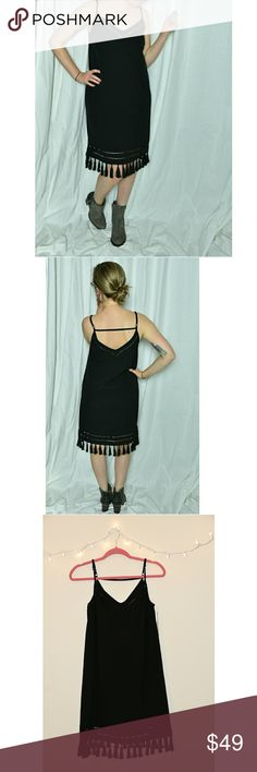 NWT Gianni Bini Black Dress with Tassels New with tags! It's the little black dress with character! V-Neckline on front and back with a horizontal strap running across the back and small cutout accents below the neckline and near the hem makes this dress simple yet stunning. Model is 5'. Retail $119, reasonable offers accepted. Bundle for a private discount! Gianni Bini Dresses